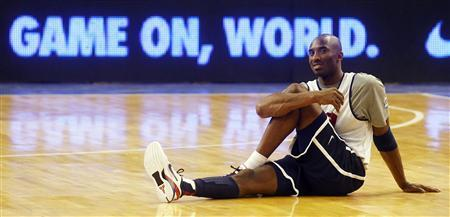 Olympic basketball player Kobe Bryant stretches during a training session at Palau Sant Jordi in Barcelona, July 21, 2012